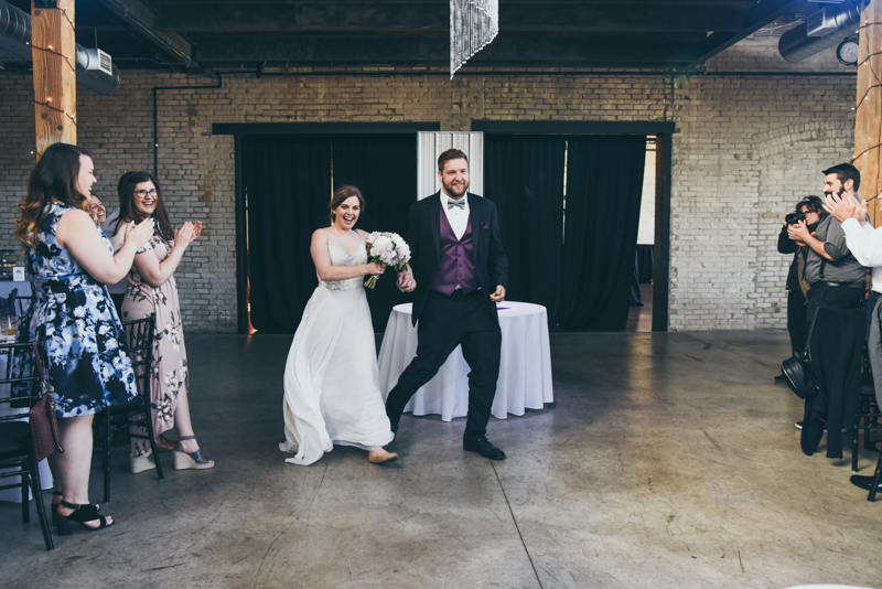 bride and groom's funny entrance into wedding reception