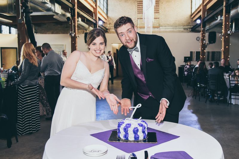 couple cutting cake at wedding reception