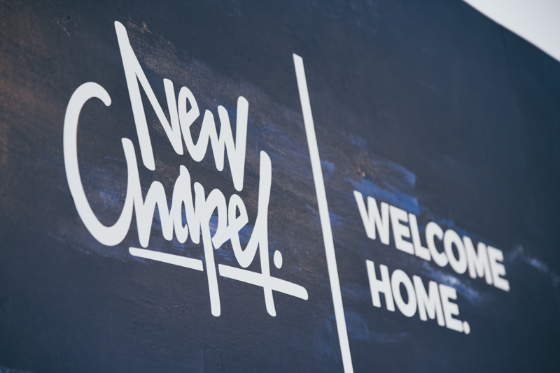 image of new chapel church's welcome sign in grand rapids michigan