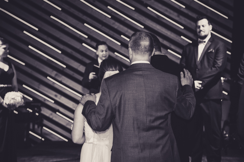father blessing his daughter and new son in law at their wedding