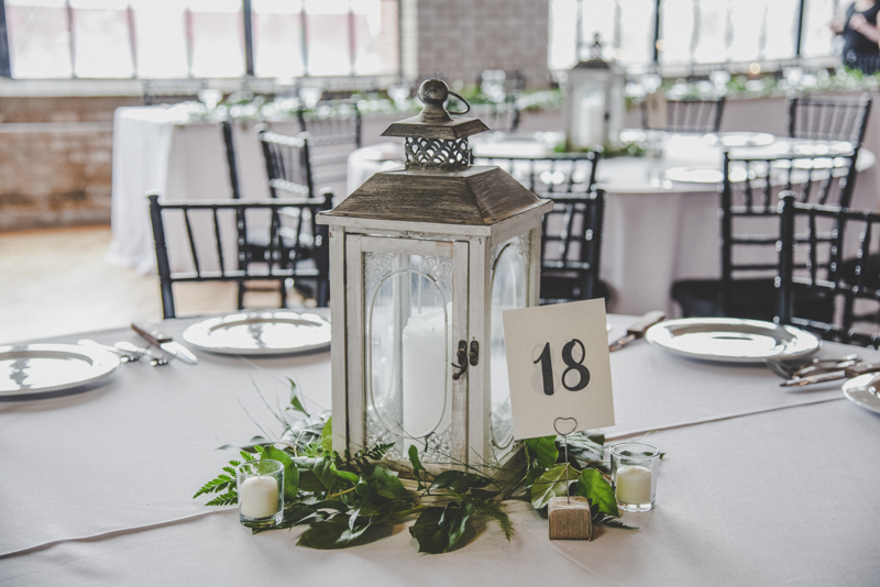 Gray Lantern centerpiece with greenery and candles