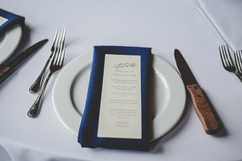 Plates and menu with wood handled knife for wedding table