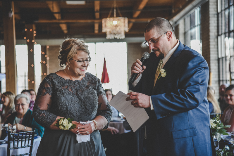 parents giving a toast at a wedding