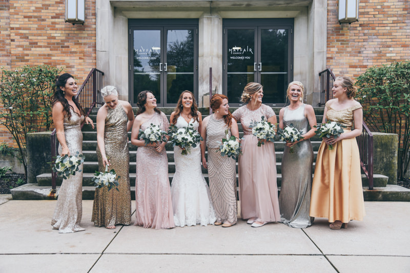 bridesmaids laughing in front of the church