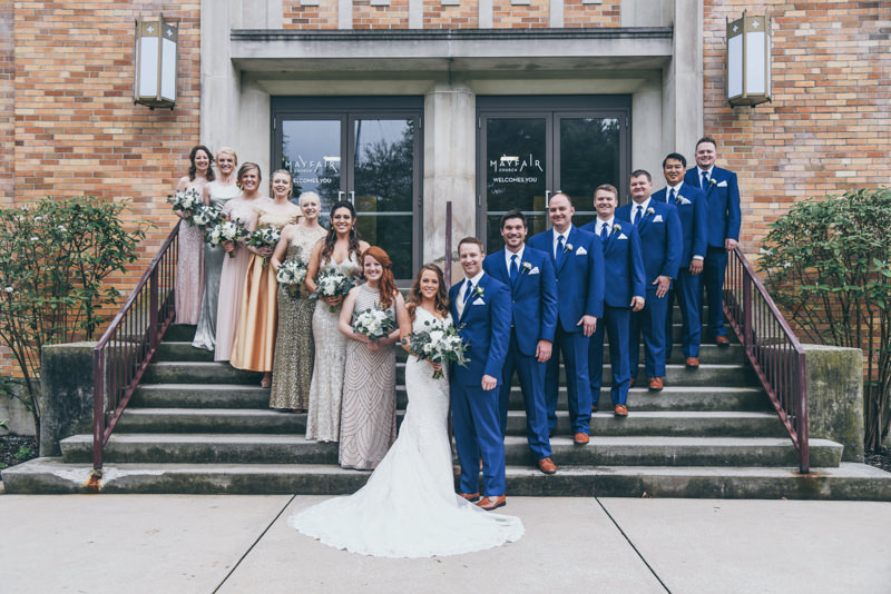 bridal party on the steps in front of the church