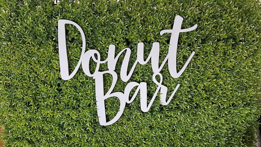 donut bar sign on green astro turf