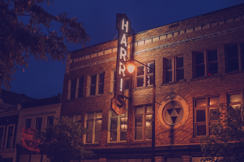 view of the historic Harris building and light at night