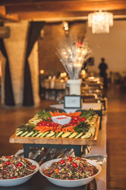 view of dinner buffet in a wedding venue