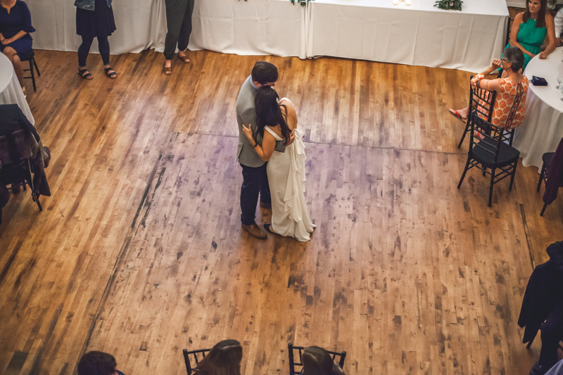 bride and groom's first dance in an old historic brick wedding venue