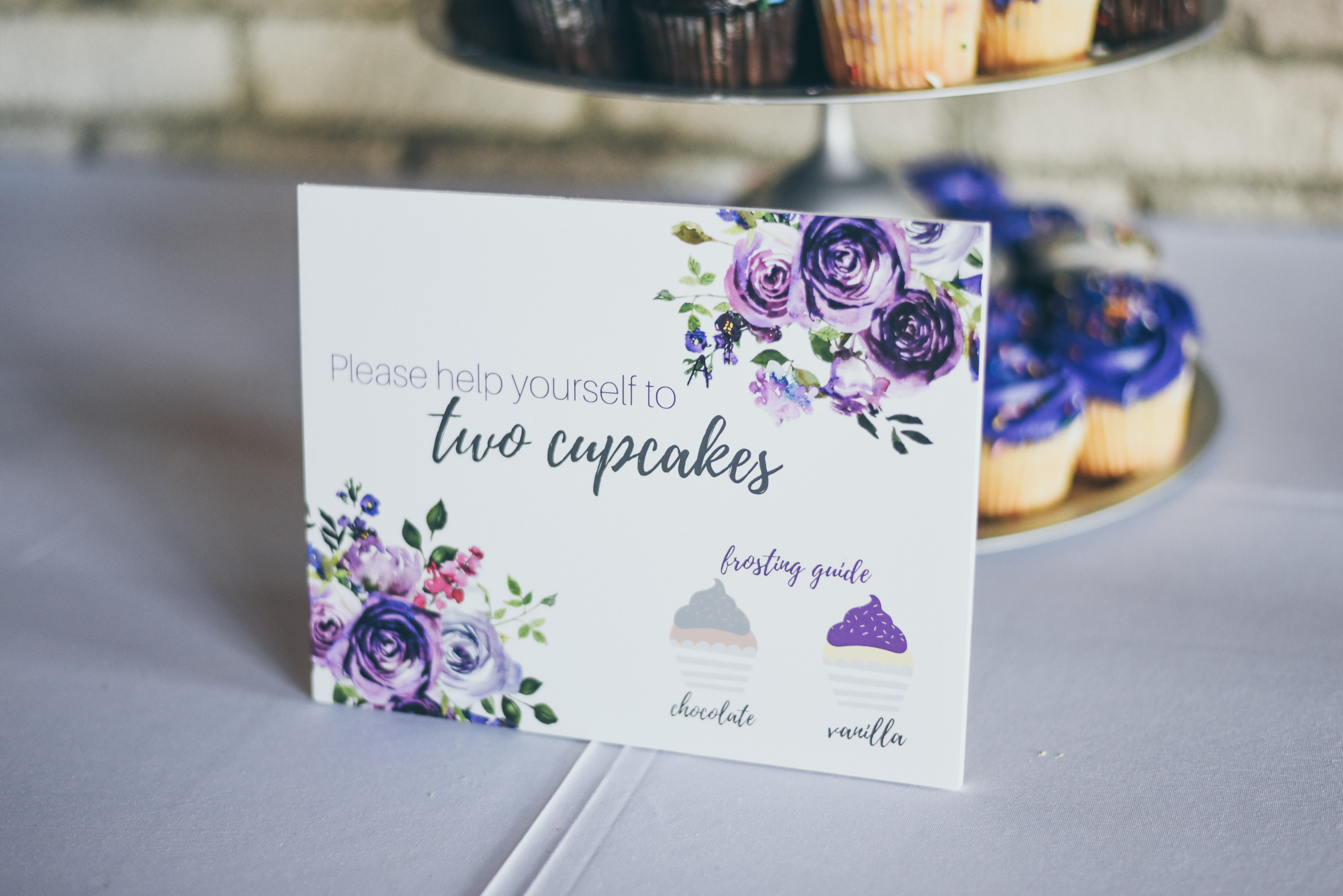 cupcake sign with silver and purple accents
