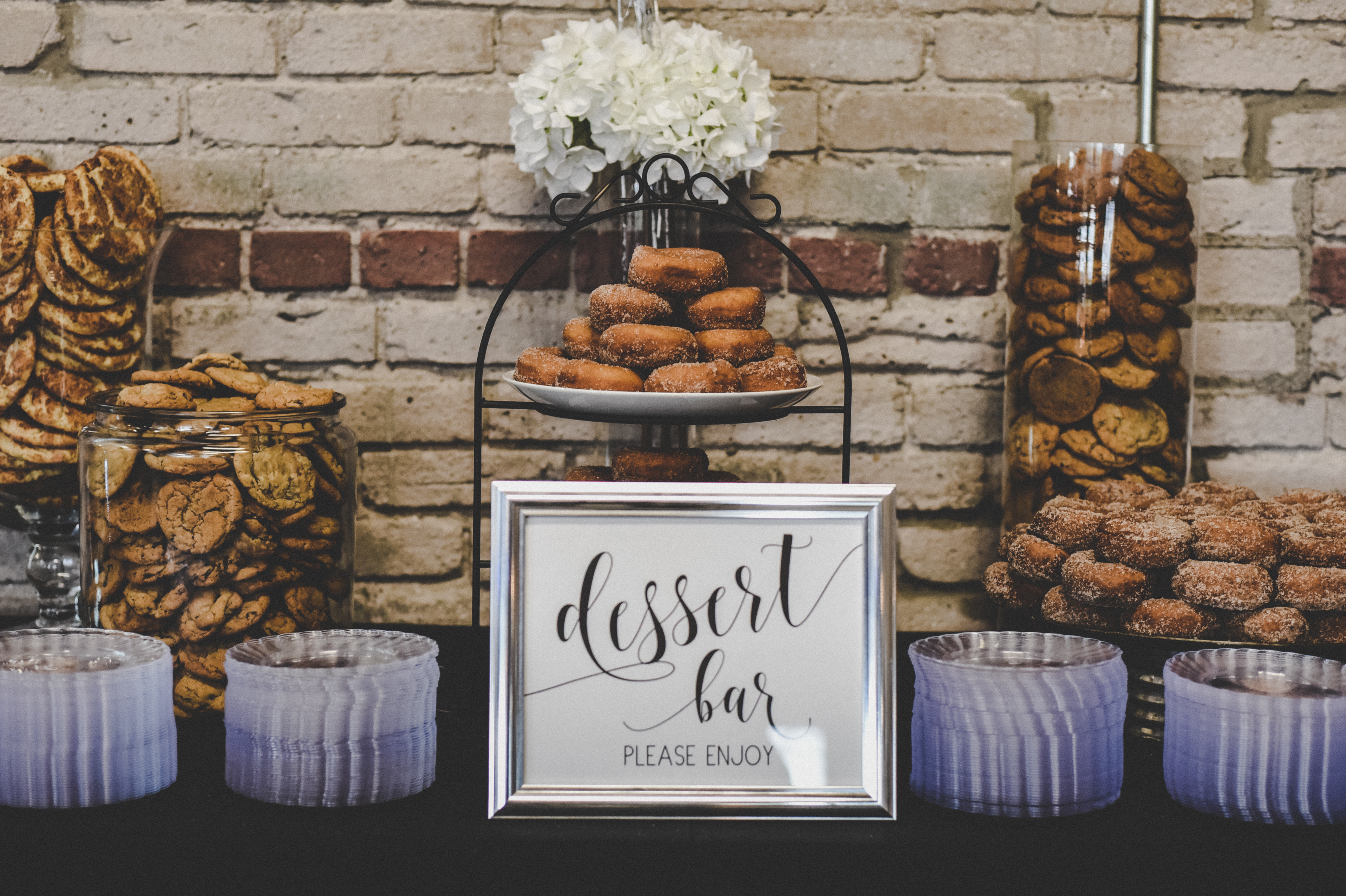 wedding dessert bar with donuts and baked goods