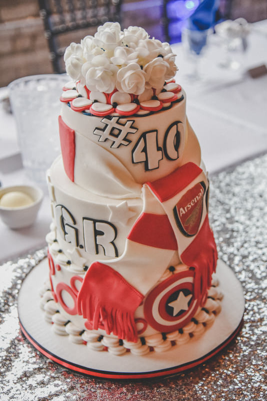 red and white hockey themed wedding cake