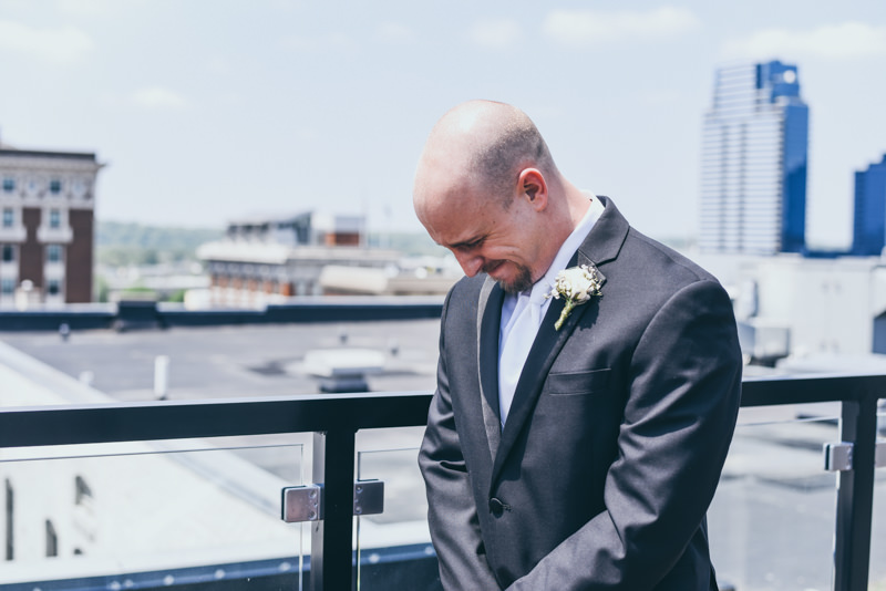 groom crying as he sees his bride for the first time