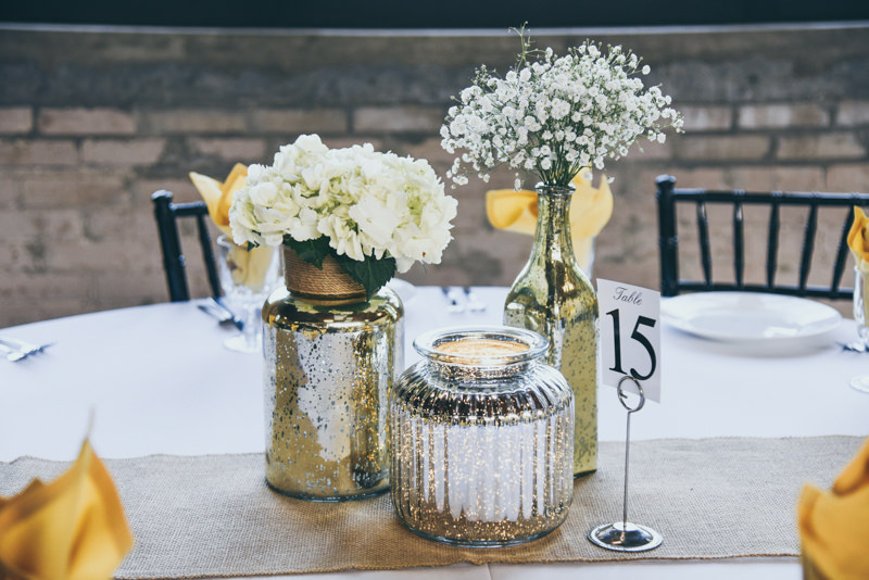 gold vases with white flowers
