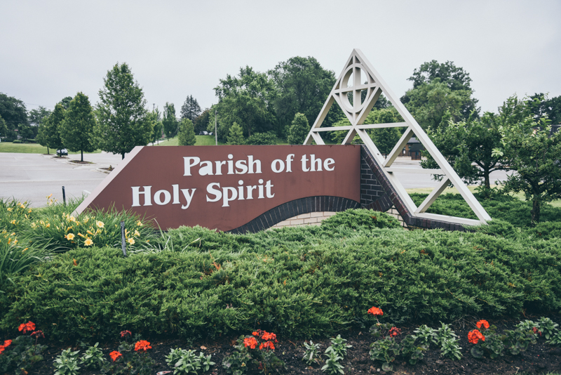 photo of a church sign surrounded by landscaping