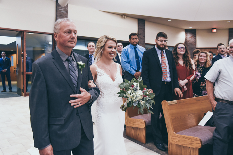 dad walking his daughter down the aisle at her wedding