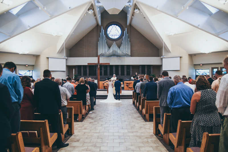 Wide image of catholic church during a wedding
