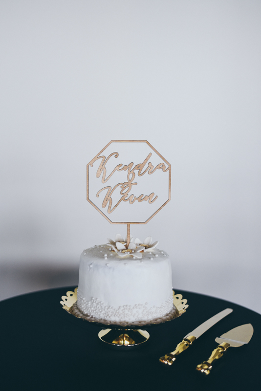 gold accented wedding cake