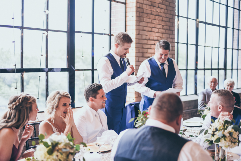groomsmen giving speech at wedding