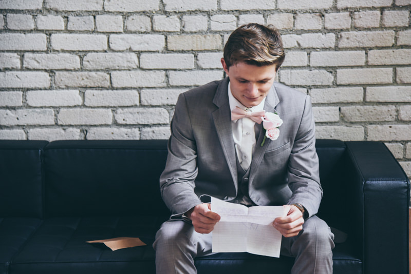 groom reading a letter from the bride before the ceremony