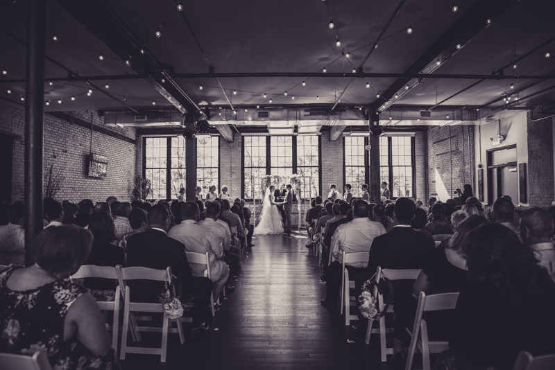 black and white image of a loft wedding venue ceremony