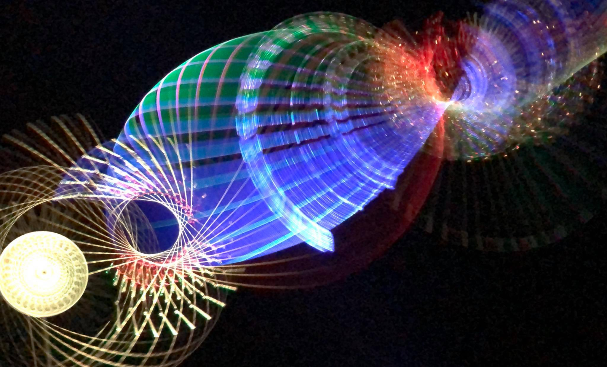 multi colored artwork using strings and strobe lights
