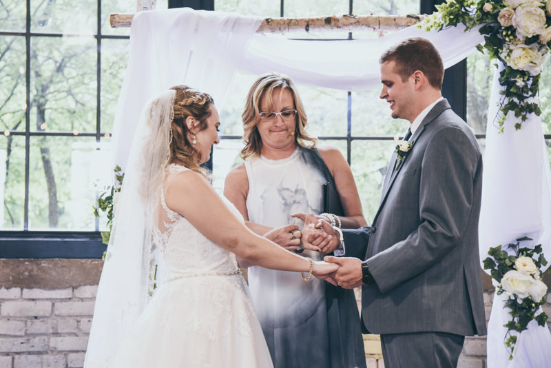 bride and groom handcuffing themselves together during ceremony