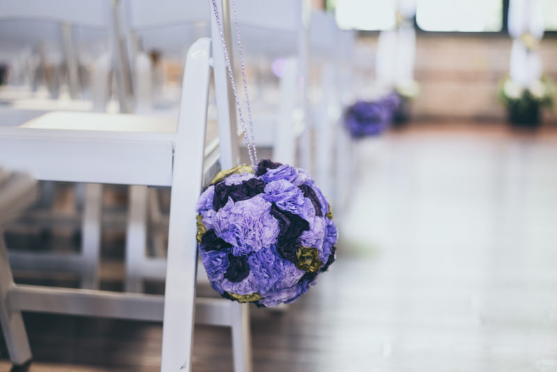 purple flower ball aisle decor