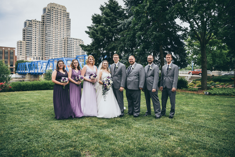 photo of the bridal party with the Grand Rapids Skyline and Blue bridge behind them