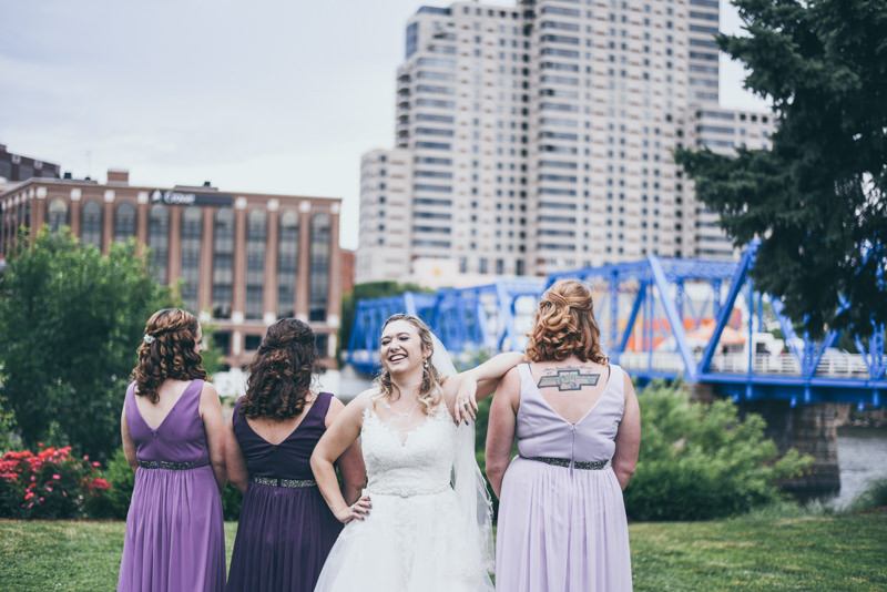 bride and bridesmaids having fun in a city scene