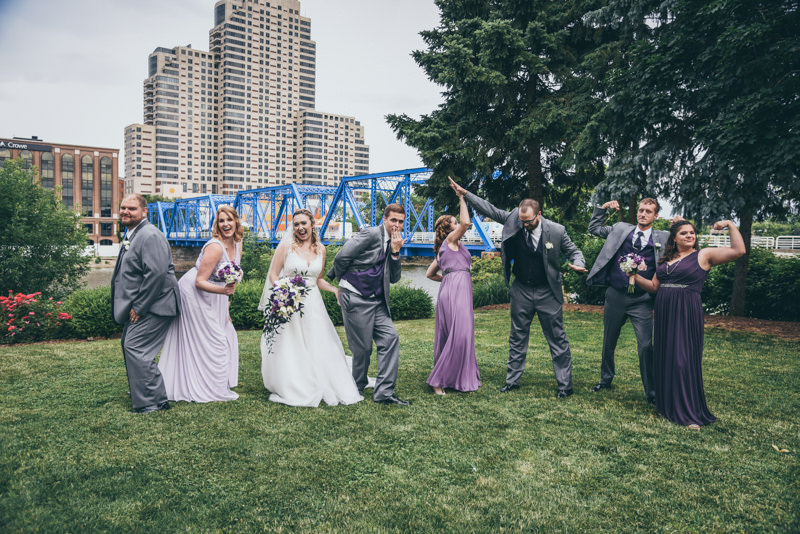 bridal party doing crazy poses in a city