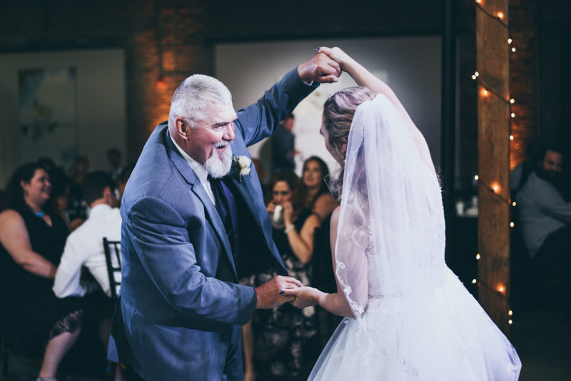father and daughter dance in a loft venue