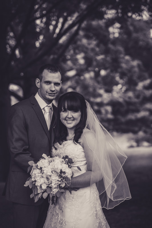 black and white image of a bride and groom