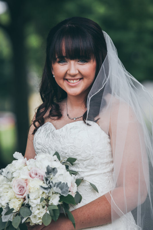 bride smiling outdoors during photos