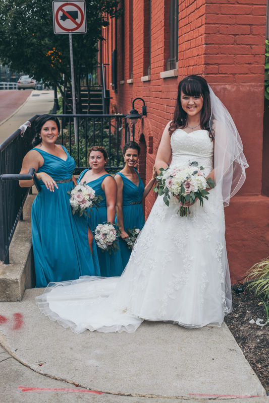 bride and bridesmaids in a stairwell
