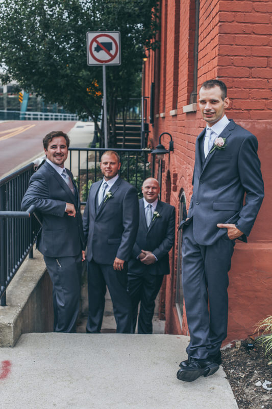 groom and groomsmen in a stairwell