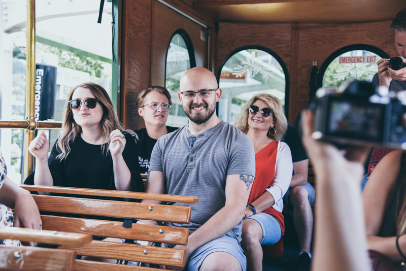 group having fun on an open air trolley