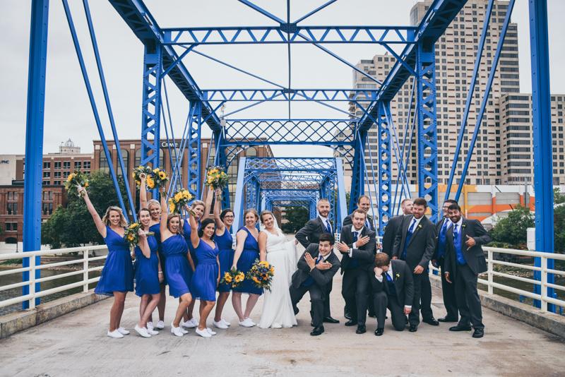 bridal party photos on a blue bridge