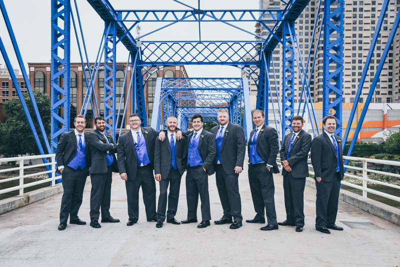 bridal party photos on a blue bridge