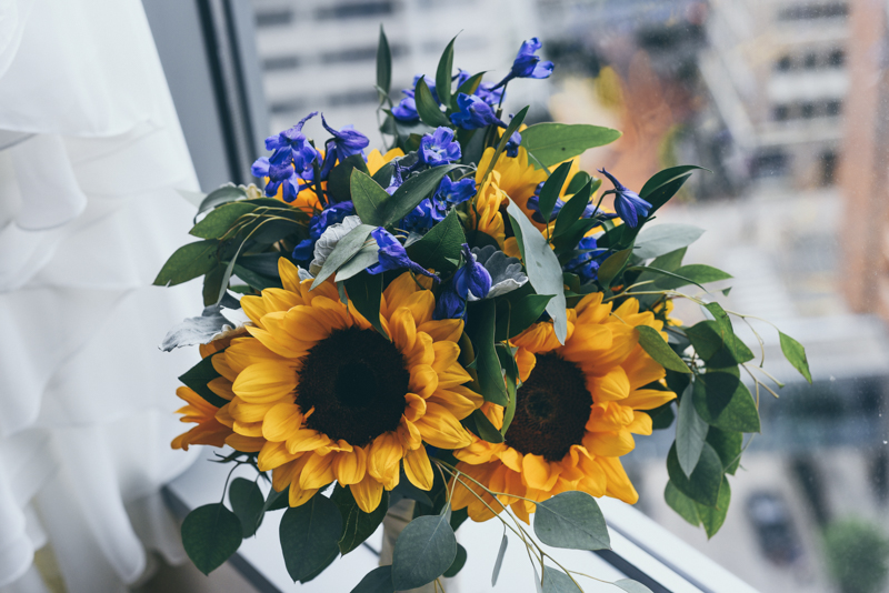 beautiful bridal bouquet with sunflowers and blue delphinium