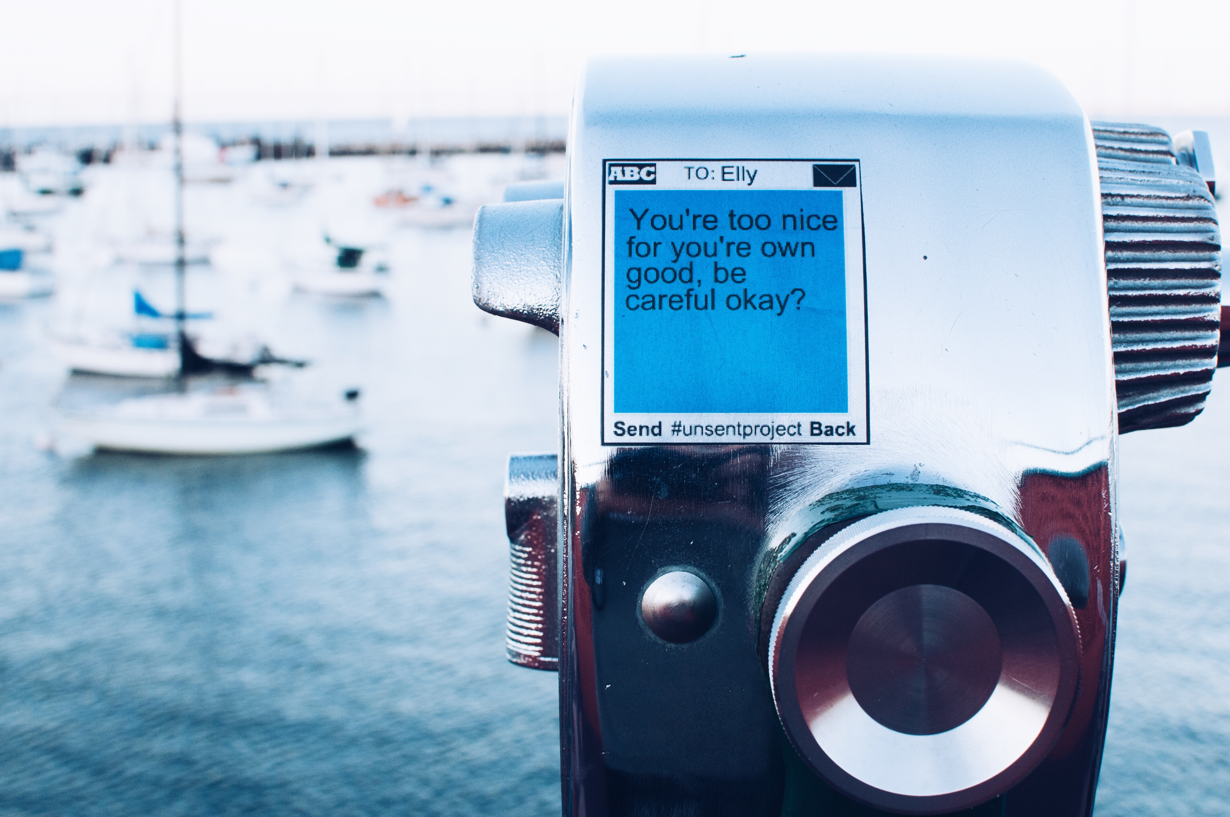 image of a conceptual artpiece transposed over an image of a camera and the ocean