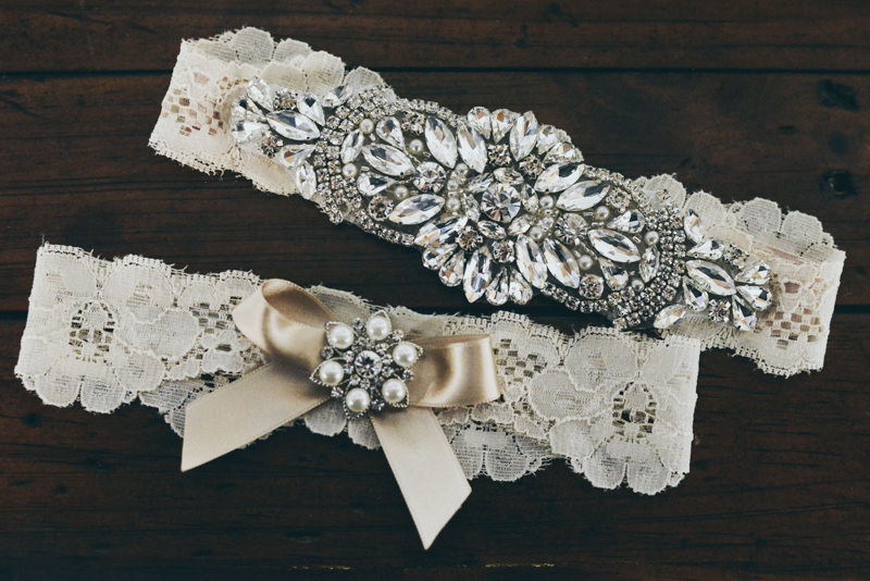 An ivory and rhinestone bridal garter set