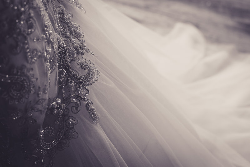 close up of a jeweled wedding gown