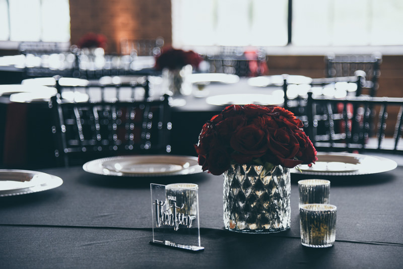 rich red roses in a crystal vase at a wedding reception