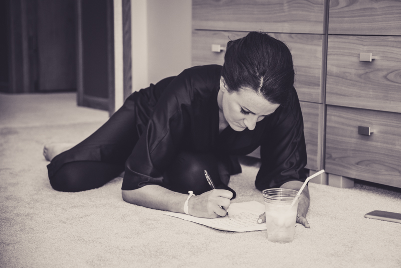 bride laying on the floor to write her vows