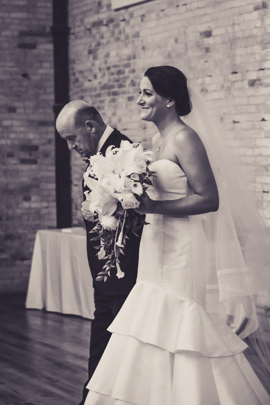 bride waiting to be escorted down the aisle by her father