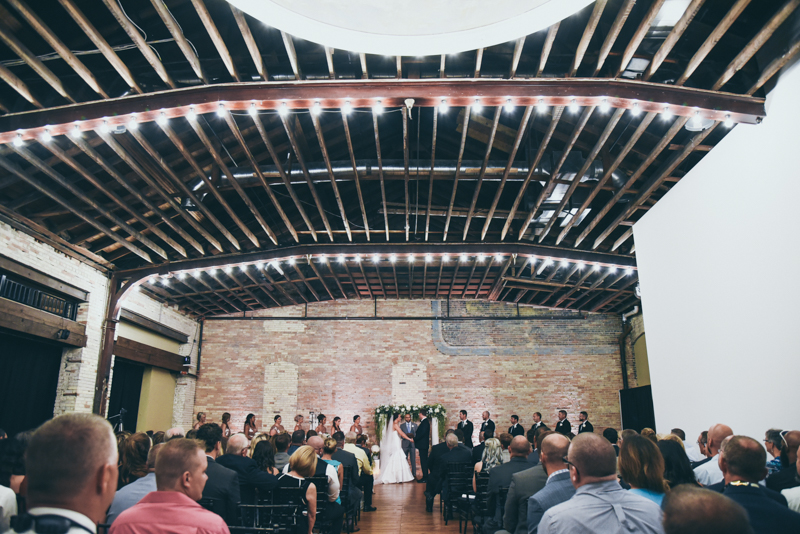 wide shot of a wedding ceremony in an old buildings