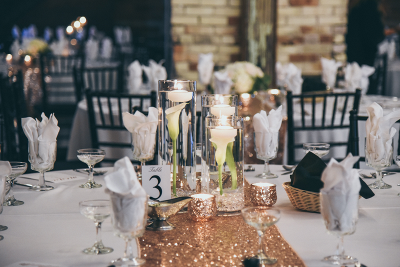 glittering rose gold sequin runner with a floral bouquet centerpiece