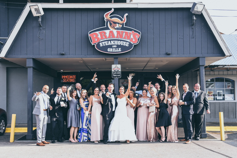 bridal party in front of Brann's restaurant in grand Rapids mi