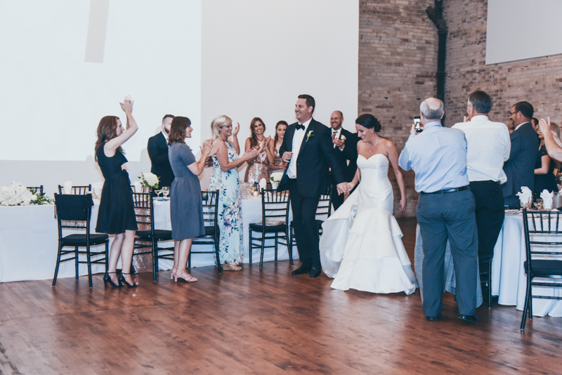 bride and groom's grand entrance into a reception